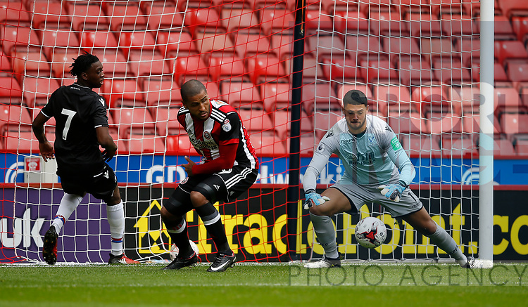 Dion Henry of Crystal Palace makes a save at the feet of Leon Clarke of Sheffield Utd during the Professional Development U23 match at Bramall Lane, Sheffield. Picture date 4th September 2017. Picture credit should read: Simon Bellis/Sportimage