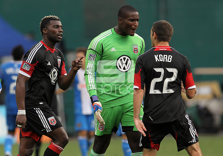 WASHINGTON, D.C. - AUGUST 19, 2012:  Brandon McDonald (4) and Bill Hamid (28) confront Chris Kolb (22) at the end of an MLS match against the Philadelphia Union at RFK Stadium, in Washington DC, on August 19. The game ended in a 1-1 tie.