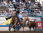 Clint Summers competes in the team roping event at the Reno Rodeo in Reno, Nev., on Thursday, June 27, 2013.<br /> Photo by Cathleen Allison