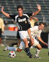 04 September 2009: Michael Thomas #8 of the University of Notre Dame shields the ball from Sean Randolph #11 of Wake Forest University during an Adidas Soccer Classic match at the University of Indiana in Bloomington, In. The game ended in a 1-1 tie..
