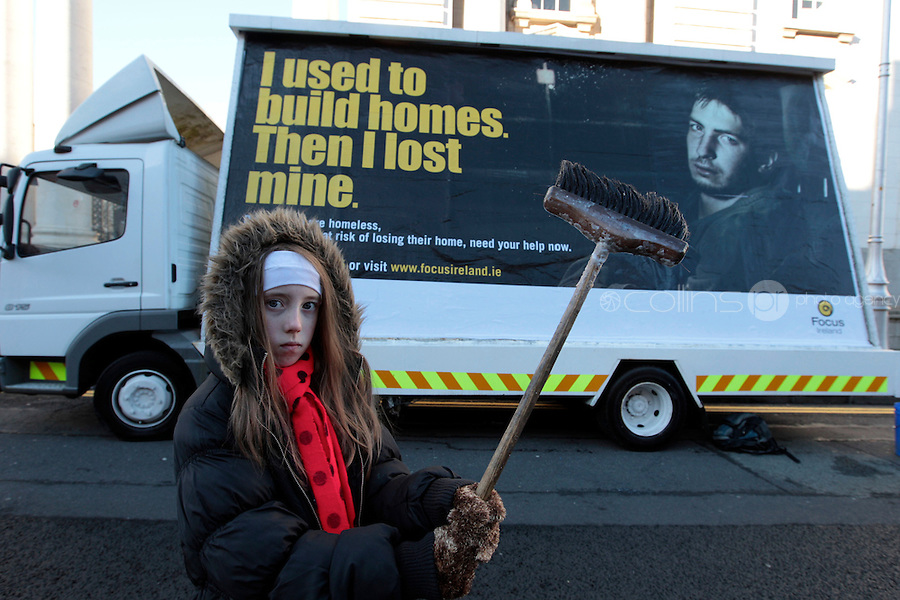 NO FEE PICTURES 14/11/10 Sheila Loughnane, age 12 at the launch of Focus Ireland's  new hard-hitting campaign outside Government Buildings (Sunday Nov 14th) with a poster highlighting people who are homeless due to the recession.  The campaign kicks off later this week with billboard, outdoor and radio ads to highlight the different faces of homelessnes. Picture:Arthur Carron/Collins
