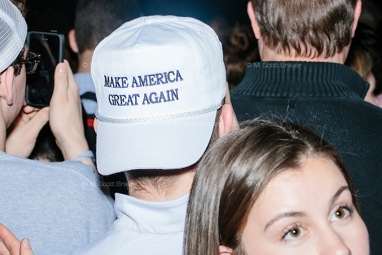 "A person wears a hat reading ""Make America Great Again"" in the audience as real estate mogul and Republican presidential candidate Donald Trump speaks at a rally at Exeter Town Hall in Exeter, New Hampshire, on Thurs., Feb. 4, 2016."