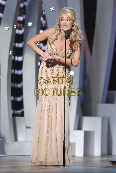 CARRIE UNDERWOOD.2007 CMA Awards, Country Music's Biggest Night, held at the Sommet Center, Nashville, Tennessee, USA, .07 November 2007..live show on stage full length cream gold beaded dress funny.CAP/ADM/LF.©Laura Farr/AdMedia/Capital Pictures.