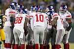 New York Giants quarterback Eli Manning (10) calls a play in the huddle during an NFL divisional playoff football game against the Green Bay Packers on January 15, 2012 in Green Bay, Wisconsin. The Giants won 37-20. (AP Photo/David Stluka)