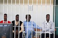 Da sinistra, Mohamed Isse Karshe, Abdi Hassan Mahamur, Ahmed Malimed Ali e Abdullahi Ali Ahmed, presunti pirati somali accusati dell'attacco alla nave portacontainer italiana Montecristo, durante la prima udienza del processo presso la III Corte d'Assise a Roma, 23 marzo 2012. La nave, assaltata il 10 ottobre 2011 al largo della Somalia, venne liberata il 15 ottobre dai Royal Marines britannici con l'ausilio di una nave militare statunitense..Somali allegedly pirates, from left, Mohamed Isse Karshe, Abdi Hassan Mahamur, Ahmed Malimed Ali and Abdullahi Ali Ahmed, sit inside a cage during the opening audience for the assault to the Montecristo container ship, in Rome, 23 march 2012. The ship was attacked on 10 october 2011 and freed by US navy and British Royal Marines on 15 october..UPDATE IMAGES PRESS/Riccardo De Luca