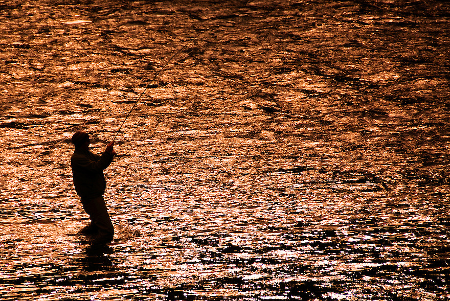 Brady Hughes of Livingston, Montana, battles a trout on the Madison River in the Lee Metcalf Wilderness.