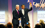 Former President Bill Clinton and President Barack Obama at the Clinton Global Initiative 2009 in New York City.