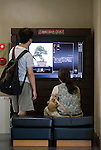 Visitors look at a touch-panel display  at the Saitama Omiya Bonsai Museum of Art in Saitama, Japan on 15 Aug. 2011..Photographer: Robert Gilhooly