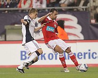 SL Benfica defender F‡bio Faria (34) crosses as New England Revolution forward Zak Boggs (33) defends. SL Benfica  defeated New England Revolution, 4-0, at Gillette Stadium on May 19, 2010.