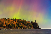 An aurora show over the lighthouse was vibrant but brief until the clouds arrived. The nearly-full moon illuminated the autumn-kissed trees. Lake Superior's gental waves lapped at the rugged shoreline, and the skies danced overhead.