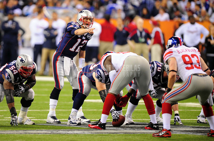 Feb 5, 2012; Indianapolis, IN, USA; New England Patriots quarterback Tom Brady (12) gestures at the line of scrimmage during the first half of Super Bowl XLVI against the New York Giants at Lucas Oil Stadium.  Mandatory Credit: Mark J. Rebilas-