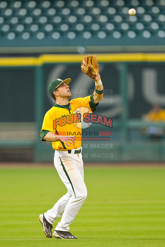Shortstop Landis Ware #5 of the Baylor Bears catches a pop fly against the Rice Owls at Minute Maid Park on March 6, 2011 in Houston, Texas.  Photo by Brian Westerholt / Four Seam Images