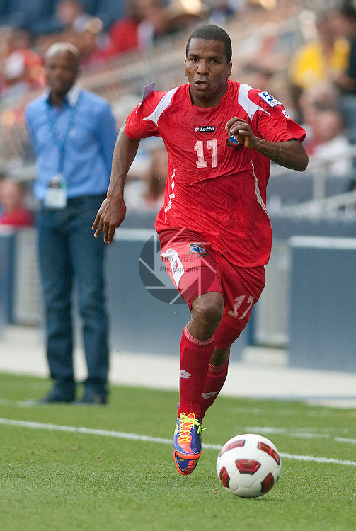 14 June 2011                         Panama defender Luis Henríquez (17) dribbles the ball in first half action.  Behind him is Panama head coach Julio Dely Valdes. The Panama Men's National Soccer Team played against the Canada Men's National Soccer Team in the first qualifying round of the CONCACAF Gold Cup game at Livestrong Sporting Park in Kansas City, KS on June 14, 2011.