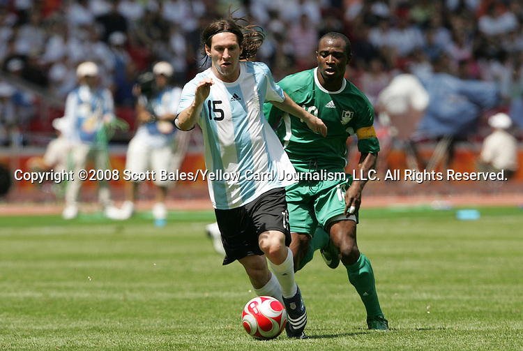 23 August 2008: Lionel Messi (ARG) (15) and Promise Isaac (NGA) (10). Argentina's Men's Olympic Team defeated Nigeria's Men's Olympic Team 1-0 at the National Stadium, known as the Bird's Nest, in Beijing, China in the Gold Medal match in the Men's Olympic Football tournament.