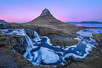 Kirkjufell is a 1500ft high mountain on the North coast of Iceland's Snæfellsnes peninsula.  The lights of the small town of Grundarfjörður reflet just behind me.  Soon after this photo, the moon rose over the mountain range just beyond the town.  Iceland was made up of many such magical moments.