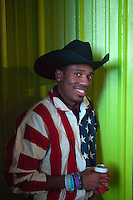 A man wearing an American flag jacket poses for a photo during the Barbecue World Chamopionship Cook-Off at the 2015 RodeoHouston.