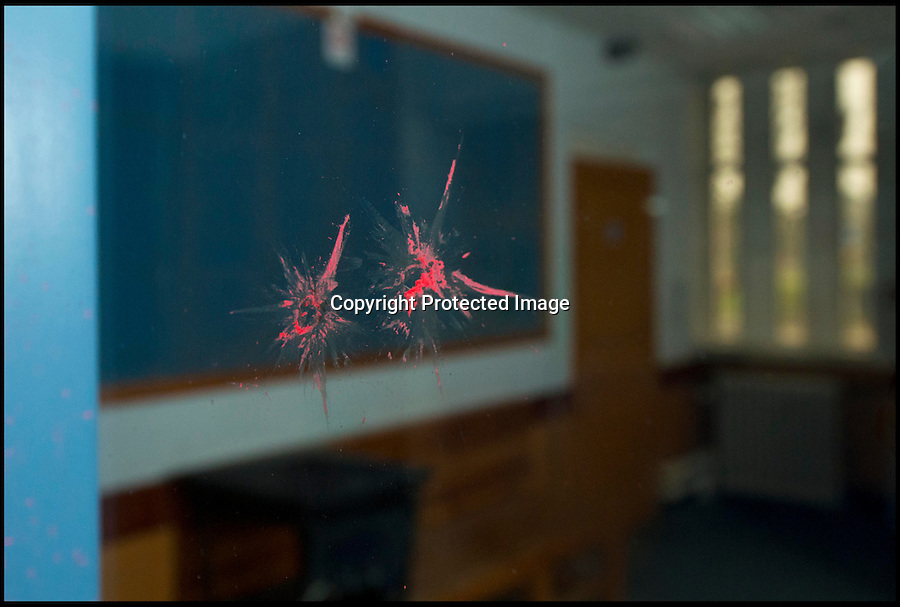 BNPS.co.uk (01202 558833)<br /> Pic: RachelAdams/BNPS<br /> <br /> Marks made by plastic bullets on the reception glass. <br /> <br /> Potential buyers of this property that is for sale will hope to get it for a real steal.<br /> <br /> The three-storey building is actually a derelict police station that used to house scores of police officers and dozens of prisoners.<br /> <br /> The building used to serve as the main police station for Poole, Dorset, until 2009 when the force moved to a state-of-the-art HQ nearby.<br /> <br /> The 1930s building, that sits a 0.89 of an acre site, has lain mostly empty since then, at a cost of hundreds of thousands of pounds a year to the taxpayer.<br /> <br /> It is now gone on the market with interested parties invited to make sealed bids.