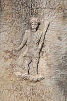 Roman carving of Aulisua, the African and Mauretanian god of fertility, with inscription, 1st - 3rd century AD, Volubilis, Northern Morocco. Volubilis was founded in the 3rd century BC by the Phoenicians and was a Roman settlement from the 1st century AD. Volubilis was a thriving Roman olive growing town until 280 AD and was settled until the 11th century. The buildings were largely destroyed by an earthquake in the 18th century and have since been excavated and partly restored. Volubilis was listed as a UNESCO World Heritage Site in 1997. Picture by Manuel Cohen