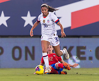 , FL - : Margaret Purce #30 of the United States steps through the tackle of Lixy Rodriguez #12 of Costa Rica during a game between  at  on ,  in , Florida.