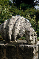One of Jean Cocteau's avant-garde sculptures graces a stone wall in the garden