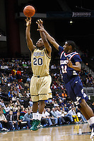 February 03, 2011:   Jacksonville Dolphins guard Keith McDougald (20) goes up for a jump shot over the reach of  Belmont Bruins guard Ian Clark (21) during Atlantic Sun Conference action between the Jacksonville Dolphins and the Belmont Bruins at Veterans Memorial Arena in Jacksonville, Florida.  Belmont defeated Jacksonville 76-70.