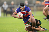 Fotu Lokotui gets taken to ground by Gene Te Amo. Counties Manukau Premier Club Rugby game between Ardmore Marist and Manurewa, played at Bruce Pulman Park Papakura on Saturday May 12th 2018. Ardmore Marist won the game 20 - 3 after leading 17 - 3 at halftime.<br /> Ardmore Marist - Katetistoti Nginingini try, penalty try, Latiume Fosita conversion, Latiume Fosita 2 penalties.<br /> Manurewa - Logan Fonoti penalty.<br /> Photo by Richard Spranger.