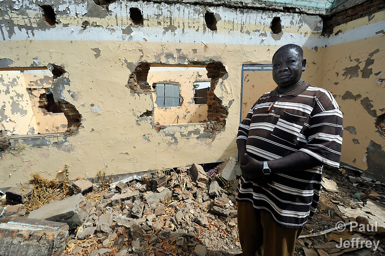 Father Karlo Kaw stands in the ruins of the priests residence in the Catholic Church compound in the town of Abyei, at the center of the contested Abyei region along the border between Sudan and South Sudan. Residents of Abyei fled in 2011 after an attack by soldiers and militias from the northern Republic of Sudan. Although the 2005 Comprehensive Peace Agreement called for residents of Abyei to hold a referendum on whether they wanted to align with the north or the newly independent South Sudan, the government in Khartoum and northern-backed Misseriya nomads, excluded from voting as they only live part of the year in Abyei, blocked the vote and attacked the majority Dinka Ngok population. The African Union has proposed a new peace plan, including a referendum to be held in October 2013, but it has been rejected by the Misseriya and Khartoum. The Catholic parish of Abyei, with support from Caritas South Sudan and other international church partners, has maintained its pastoral presence among the displaced and assisted them with food, shelter, and other relief supplies.