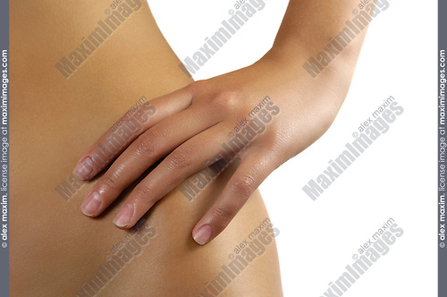 Woman with a hand on her bare hip
