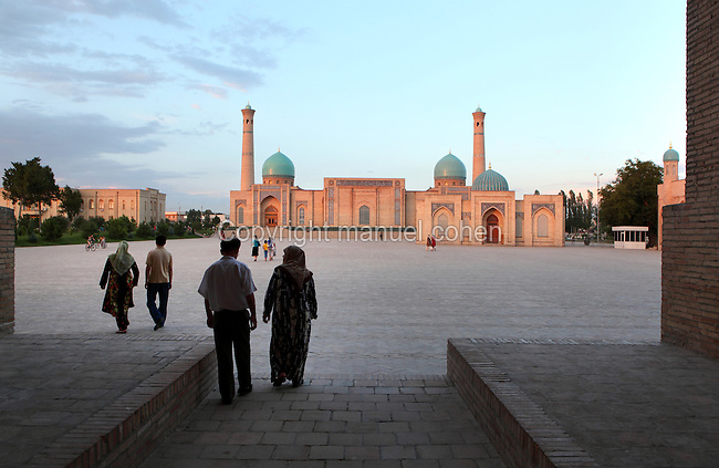 "Low angle view across Khast Imam Square to the Tellya Sheikh Mosque, founded 16th century, restored 19th century, Tashkent, Uzbekistan, pictured on July 4, 2010, in the afternoon. Tashkent's main Friday mosque holds the Osman Koran, claimed to be the world's oldest, in its library. Tashkent, 2000 year old capital city of Uzbekistan, a Silk Road city whose name means ""Stone Fortress"", is now very modern due to a disastrous earthquake in 1966, after which it was greatly rebuilt. However, some of the old buildings still stand in the glittering modern city. Picture by Manuel Cohen."