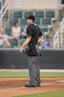 Home plate umpire Patrick Sharshel between innings of the South Atlantic League game between the Lexington Legends and the Kannapolis Intimidators at CMC-Northeast Stadium on May 26, 2015 in Kannapolis, North Carolina.  The Intimidators defeated the Legends 4-1.  (Brian Westerholt/Four Seam Images)