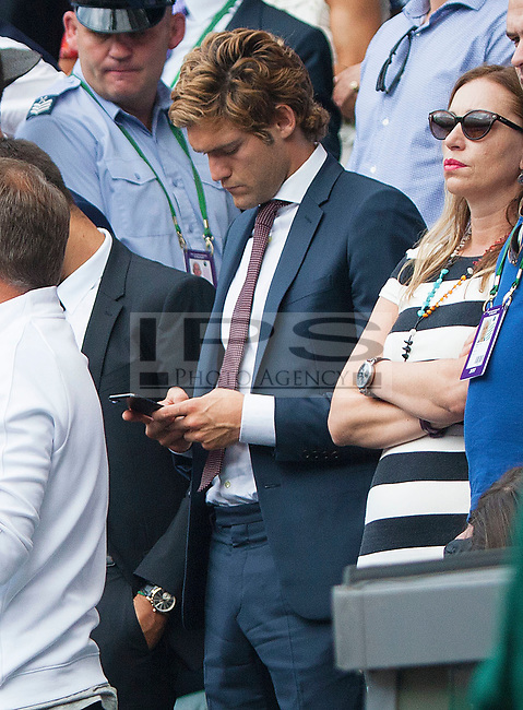 Chelsea Defender Marcos Alonso on his Mobile during a break in play on Centre Court during the Mens Final, Wimbledon Championships 2017, Day 13, Mens Final, All England Lawn Tennis & Croquet Club, Church Rd, London, United Kingdom - 16th July 2017