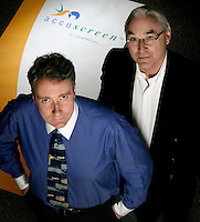 Edmonton- 5/20/04- Mark Redmond, CEO and president of CEAPRO, with Ken Pilip, senior vp. CEAPRO is planning to launch Accuscreen, a type 2 diabetes screening tool, sometime in 2005. Photo by Ian Jackson