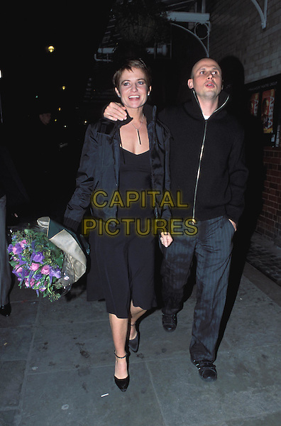 PATSY PALMER & husband NICK LOVE.Mum's The Word press night at the Albery Theatre.www.capitalpictures.com.©Capital Pictures.bouquet