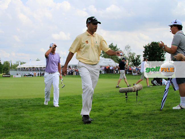 Jeev Milkha Singh (IND) and Matteo Manassero (ITA) finish on the 18th green during Day 3 of the BMW Italian Open at Royal Park I Roveri, Turin, Italy, 11th June 2011 (Photo Eoin Clarke/Golffile 2011)