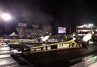 Apr 25, 2014; Baytown, TX, USA; NHRA top fuel driver Tony Schumacher (near) alongside Brittany Force during qualifying for the Spring Nationals at Royal Purple Raceway. Mandatory Credit: Mark J. Rebilas-USA TODAY Sports