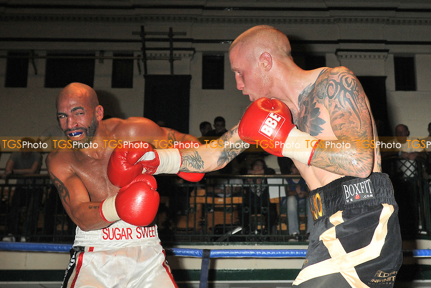 Lee Markham (black/gold shorts) defeats Bradley Pryce - Boxing at York Hall, Bethnal Green, London - 27/09/14 - MANDATORY CREDIT: Philip Sharkey/TGSPHOTO - Self billing applies where appropriate - contact@tgsphoto.co.uk - NO UNPAID USE