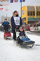 Michael Suprenant and team leave the ceremonial start line at 4th Avenue and D street in downtown Anchorage during the 2013 Iditarod race. Photo by Jim R. Kohl/IditarodPhotos.com
