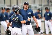 Starting pitcher David Peterson (30) of the Columbia Fireflies embraces catcher Scott Manea before a game against the Greenville Drive on Sunday, May 27, 2018, at Spirit Communications Park in Columbia, South Carolina. Greenville won, 3-0. (Tom Priddy/Four Seam Images)
