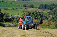 Baling silage with Ford tractor and Vicon baler, Whitewell, Lancashire....Copyright..John Eveson, Dinkling Green Farm, Whitewell, Clitheroe, Lancashire. BB7 3BN.01995 61280. 07973 482705.j.r.eveson@btinternet.com.www.johneveson.com