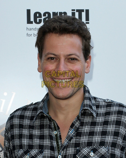 Ioan Gruffudd.Petit Ermitage Sponsors Launch of Louise Ashby Children's Fund.Held at LPB Malibu Beach House, Malibu, California, USA..August 21st, 2011.headshot portrait black shirt grey gray check  .CAP/ADM/KB.©Kevan Brooks/AdMedia/Capital Pictures.
