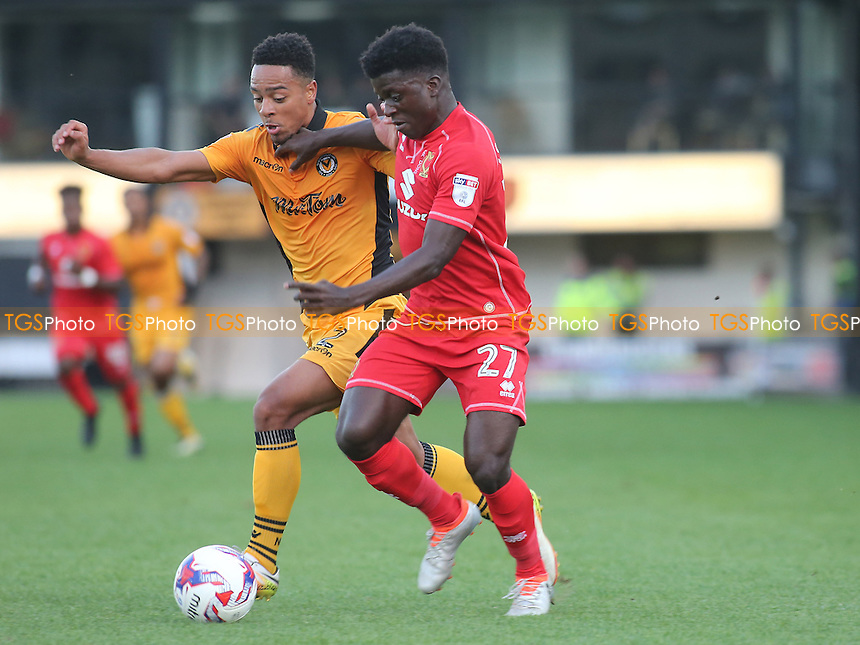 Kabongo Tshimanga of MK Dons takes on Newport's Jazzi Barnum-Bobb during Newport County vs MK Dons, EFL Cup Football at Rodney Parade on 9th August 2016
