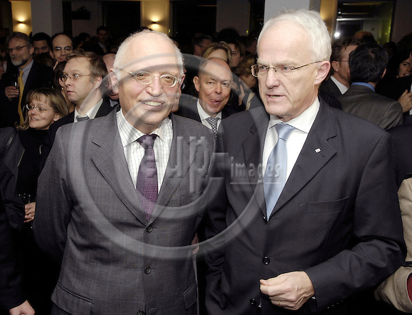 Brussels-Belgium - 26 February 2008---Opening celebration of the new Representation of the State of North Rhine-Westphalia (Germany) to the European Union with Minister-President Dr. Jürgen RÜTTGERS (Juergen Ruettgers) (ri); here, with Günter (Guenter, Gunter) VERHEUGEN (le), Vice-President of the European Commission and in charge of Enterprise and Industry---Photo: Horst Wagner / eup-images