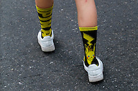 """NEW YORK, NY - JULY 24 : A woman wears socks of Pikachu as people play the augmented reality mobile game """"Pokemon Go"""" by Nintendo on July 24, 2016 in Manhattan, New York. Photo by VIEWpress"""