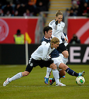 Offenbach, Germany, Friday, April 05 2013: Womans, Germany vs. USA, in the Stadium in Offenbach,  Abby Wambach (USA), Saskia Bartusiak (GER), ..