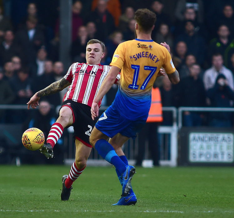 Lincoln City's Harry Anderson under pressure from Mansfield Town's Ryan Sweeney<br /> <br /> Photographer Andrew Vaughan/CameraSport<br /> <br /> The EFL Sky Bet League Two - Lincoln City v Mansfield Town - Saturday 24th November 2018 - Sincil Bank - Lincoln<br /> <br /> World Copyright © 2018 CameraSport. All rights reserved. 43 Linden Ave. Countesthorpe. Leicester. England. LE8 5PG - Tel: +44 (0) 116 277 4147 - admin@camerasport.com - www.camerasport.com