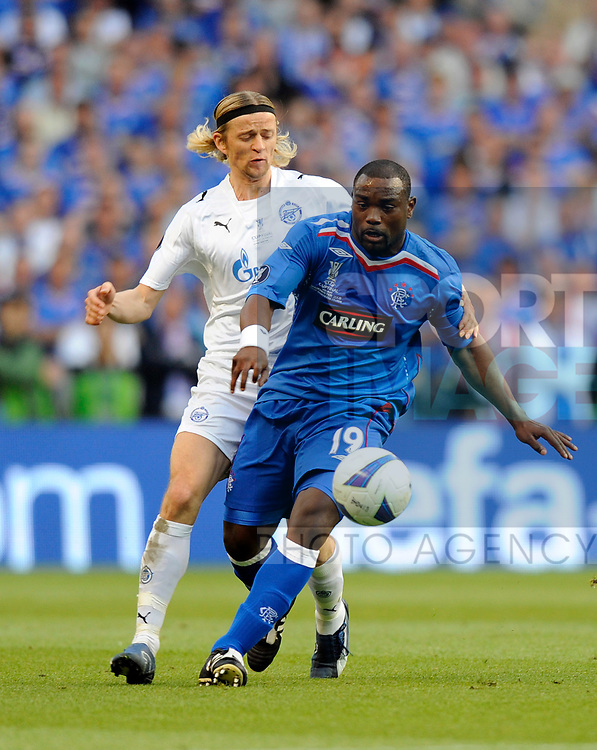 Jean-Claude Darcheville of Rangers and Anatoliy Tymoshchuk of Zenit St Petersburg during the Europa League Final match at The Etihad Stadium, Manchester. Picture date 14th May 2008. Picture credit should read: Simon Bellis/Sportimage