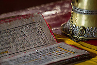 Detail of Tibetan script on prayer books at the Takthok Monastery, (Ladakh) Jammu & Kashmir, India