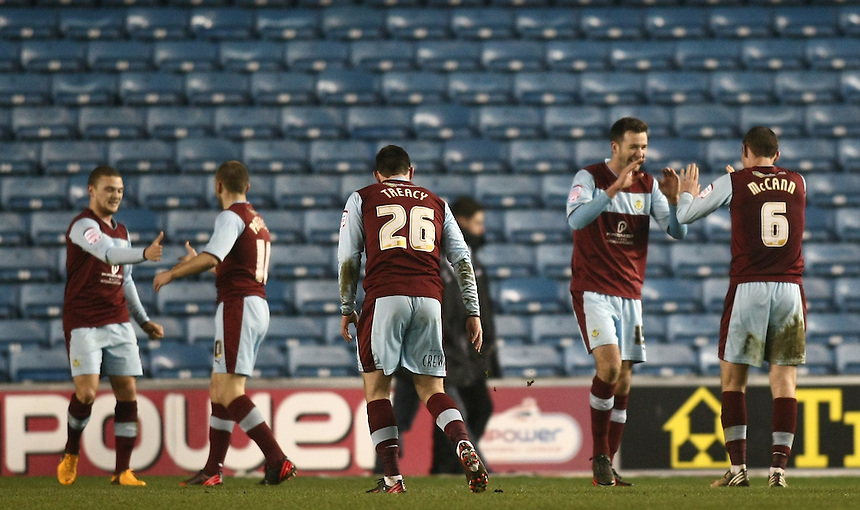 Burnley players celebrates after the final whistle.- CREDIT - CameraSport - Michael Zemanek - ..Football - npower Football League Championship - Millwall v Burnley - Saturday 19th January 2013 - The Den - London..© CameraSport - 43 Linden Ave. Countesthorpe. Leicester. England. LE8 5PG - Tel: +44 (0) 116 277 4147 - admin@camerasport.com - www.camerasport.com