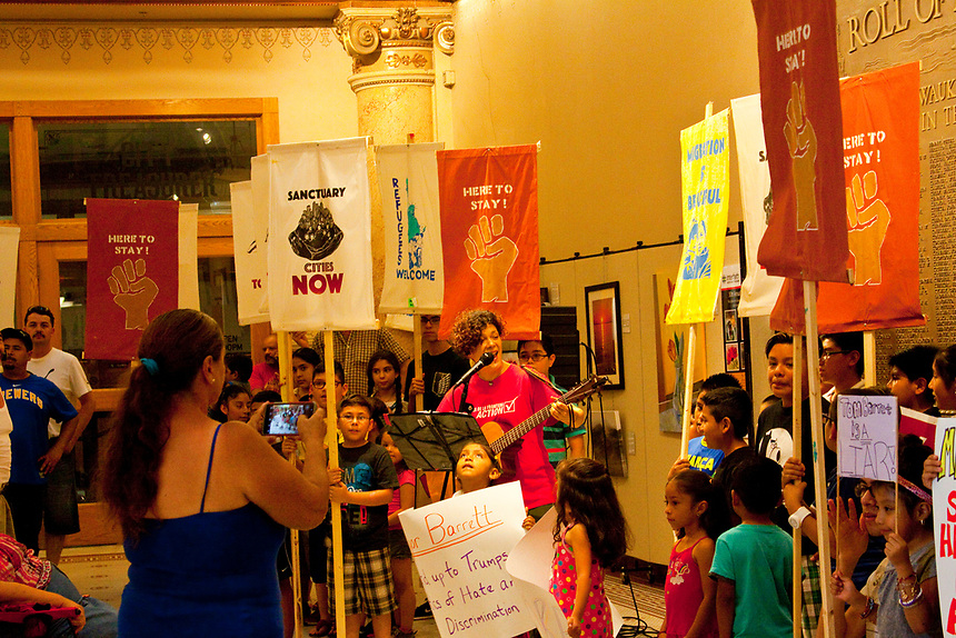The protest took place inside Milwaukee city hall. Voces de la Frontera is a Milwaukee County Hispanic advocacy group. The protest was organized to object to Milwaukee Mayor Tom Barrett's decision to allow city police to cooperate with Immigration and Customs Enforcement officers..
