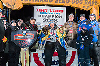Joar Leifseth Ulsom poses with his lead dogs Russeren (left) and Olive and Iditarod sponsors on the winner's podium at the finish line in Nome, Alaska early on Wednesday morning March 14th as he wins the 46th running of the 2018 Iditarod Sled Dog Race.  He finished in 9 days 12 hours 00 minutes and 00 seconds<br /> <br /> Photo by Jeff Schultz/SchultzPhoto.com  (C) 2018  ALL RIGHTS RESERVED